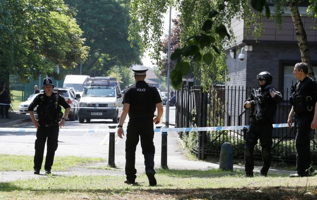 Police activity at a cordon in the Hulme area of