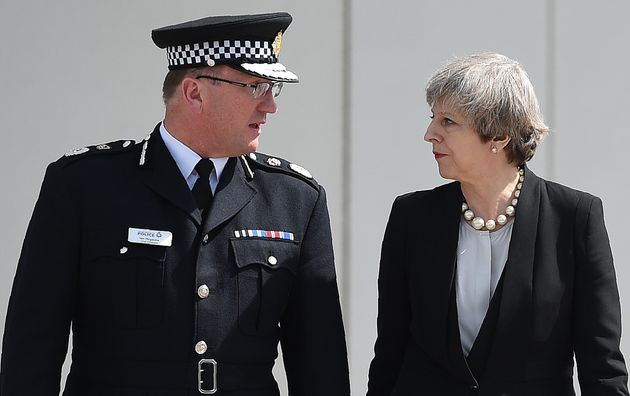 Greater Manchester Police Chief Constable Ian Hopkins and Prime Minister Theresa