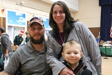 James and Stefanie Poggi with their son at the Hines VA food pantry in December.