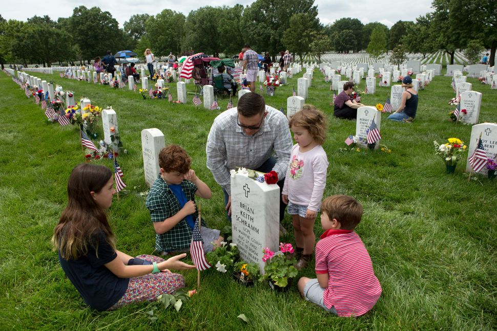 Major Clint Kappel and his children in Section 60, the burial ground for military personnel killed since 2001, at Arlington N