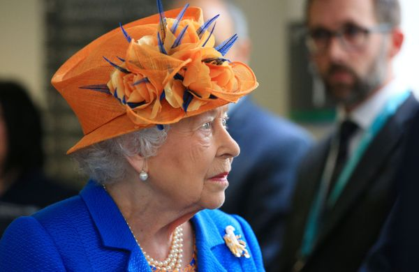 The queen wore bright colors for the visit.
