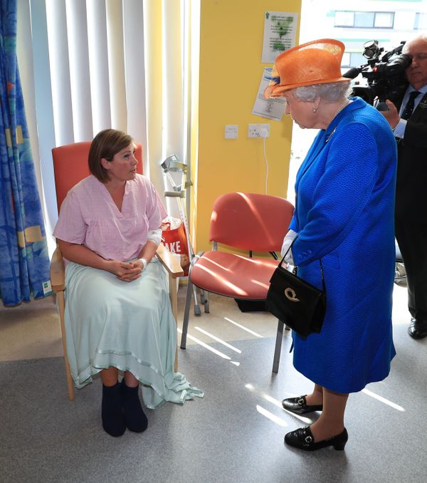 The queen speaks with Ruth Murrell, who was injured along with her 12-year-old daughter, Emily.