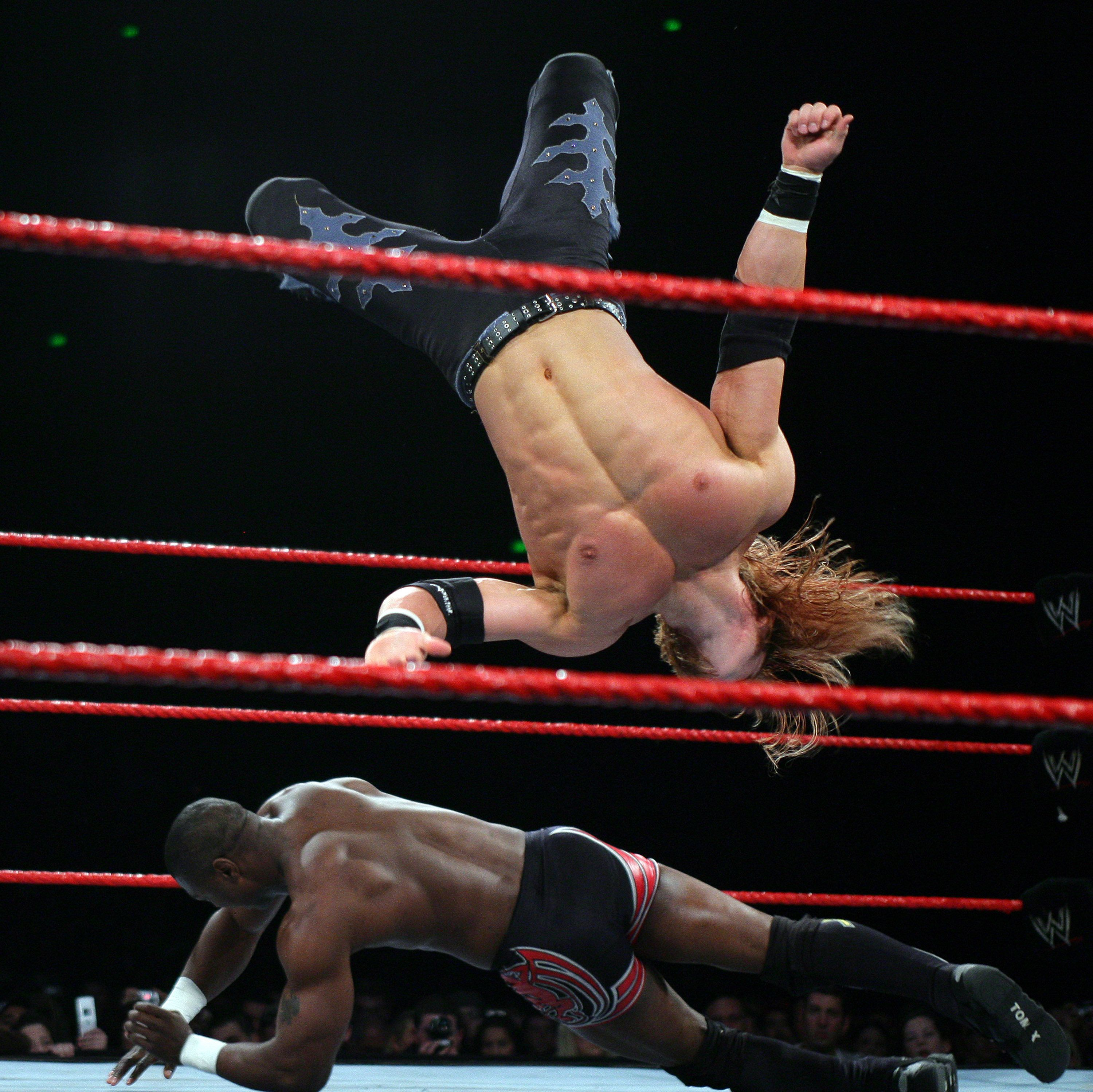 Shelton Benjamin scrambles to evade a Johnny Nitro body slam during the WWE RAW Superslam event at Acer Arena, Homebush stadium on august 4, 2006. (Photo by Don Arnold/WireImage)