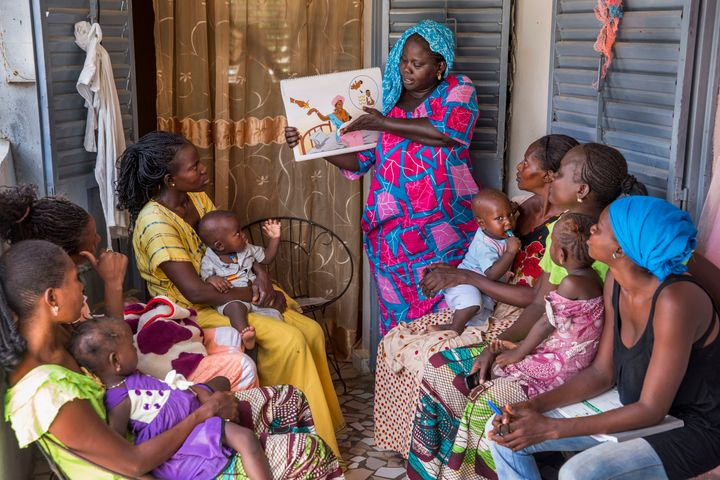 KAOLACK, SENEGAL - AUGUST 20: A community health worker providing women in her community counseling and post natal care at he