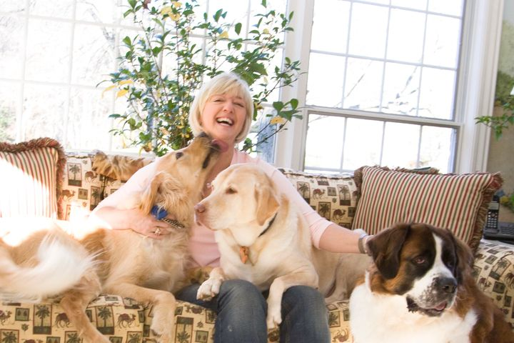 <p>Cathy Kangas with her rescue dogs</p>