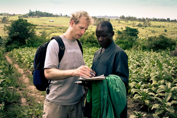 Jake Harriman talks to agriculture field manager James Magaigwa Chacha in Kenya. Nuru's development projects are locally owned and operated.