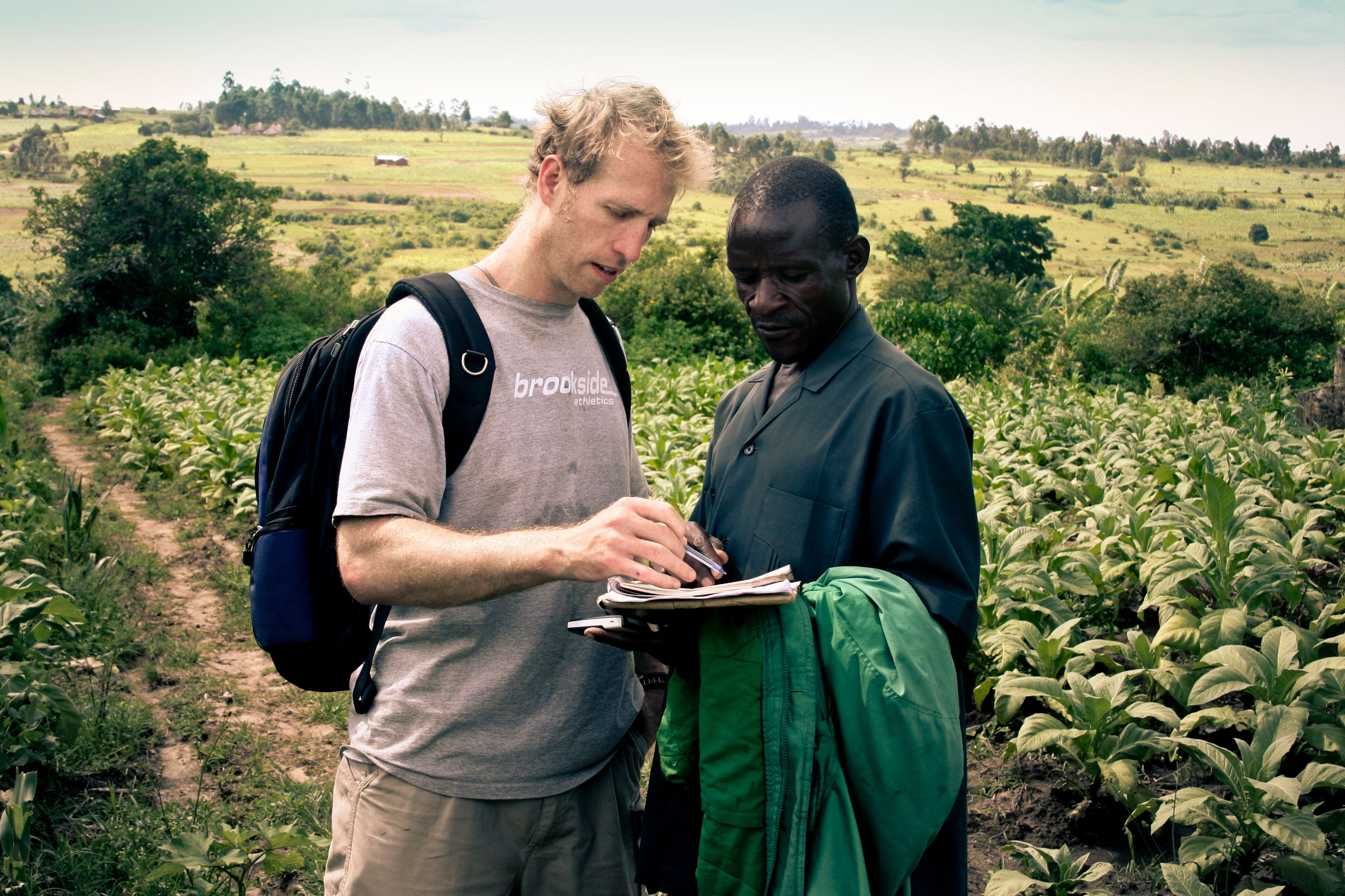Jake Harriman talks to agriculture field manager James Magaigwa Chacha in Kenya. Nuru's development projects are locally owne