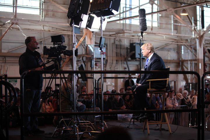 Donald Trump speaking with the media at a hangar at Mesa Gateway Airport in Mesa, Arizona.