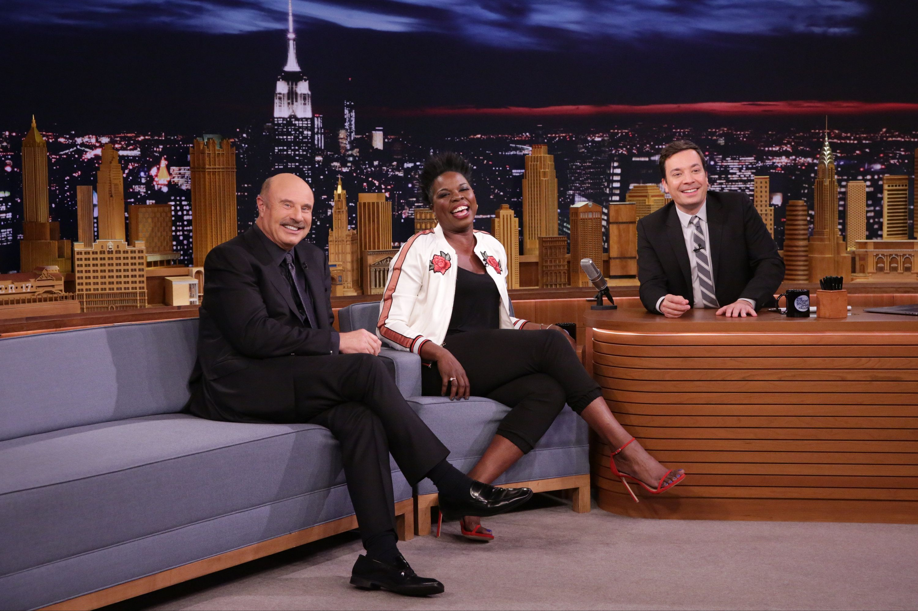 THE TONIGHT SHOW STARRING JIMMY FALLON -- Episode 0662 -- Pictured: (l-r) Talk Show Host Dr. Phil, comedian Leslie Jones, and host Jimmy Fallon during an interview on April 26, 2017 -- (Photo by: Andrew Lipovsky/NBC/NBCU Photo Bank via Getty Images)