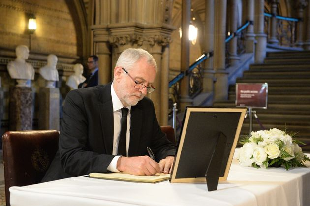 Jeremy Corbyn signs the book of condolence for attack victims at Manchester Town