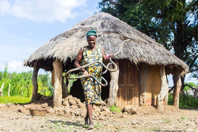 Silibaziso Ncube, 59, emerges from a neighbor's partially collapsed hut in Maphili village in Tsholotsho district in we