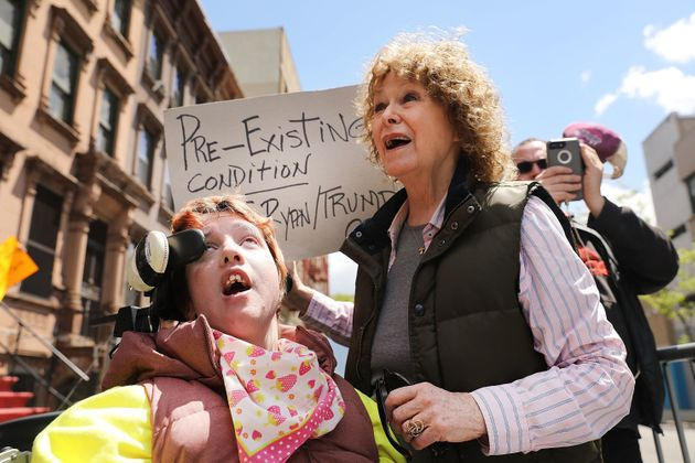 Alba Somoza, who has cerebral palsy, attends a rally with her mother and dozens of health care activists...
