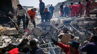 MOSUL, NINEVEH PROVINCE - MARCH 24: Local residents help Iraqi civil defense force members recover corpses trapped in the rubble of a home destroyed by reported coalition air strikes in the al-Jadida neighborhood of Mosul, Nineveh Province, on March 24, 2017. (Photo by Marcus Yam/Los Angeles Times via Getty Images)