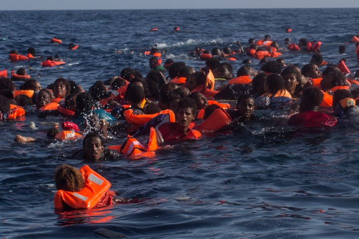 Refugees and migrants are seen swimming and yelling for assistance from crew members from the Migrant Offshore Aid Station ve