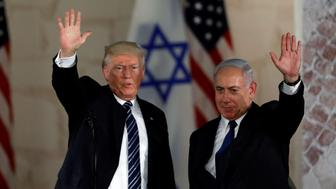 U.S. President Donald Trump and Israeli Prime Minister Benjamin Netanyahu wave after Trump's address at the Israel Museum in Jerusalem May 23, 2017. REUTERS/Ronen Zvulun