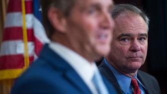 UNITED STATES - MAY 25: Sens. Tim Kaine, D-Va., right, and Jeff Flake, R-Ariz., conduct a news conference in the Capitol to introduce an authorization for use of military force (AUMF) against ISIS, al-Qaeda, and the Taliban on May 25, 2017. (Photo By Tom Williams/CQ Roll Call)