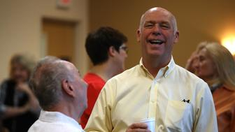 MISSOULA, MT - MAY 24:  Republican congressional candidate Greg Gianforte talks with a supporter during a campaign meet and greet at Lambros Real Estate on May 24, 2017 in Missoula, Montana.  Greg Gianforte is campaigning throughout Montana ahead of a May 25 special election to fill Montana's single congressional seat. Gianforte is in a tight race against democrat Rob Quist.  (Photo by Justin Sullivan/Getty Images)
