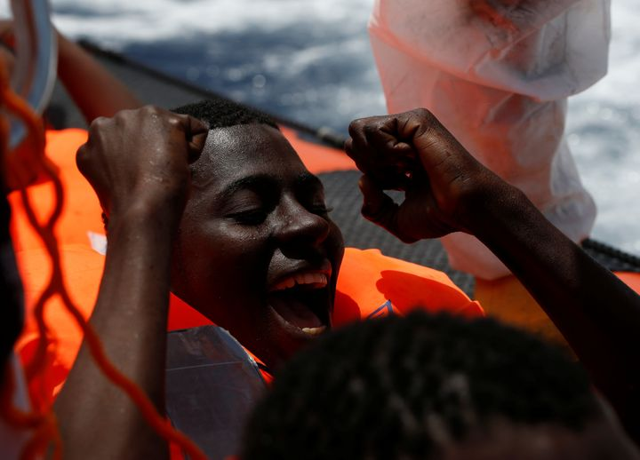 A migrant rejoices after being rescued in international waters off the Libyan coastline on March 4, 2017. Almost 363,000 peop