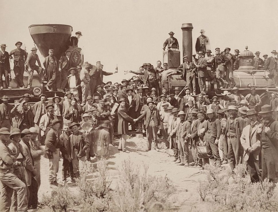 "A.J. Russell image of the celebration following the driving of the ""Last Spike"" at Promontory Summit, Utah, May 10, 1869. Bec"