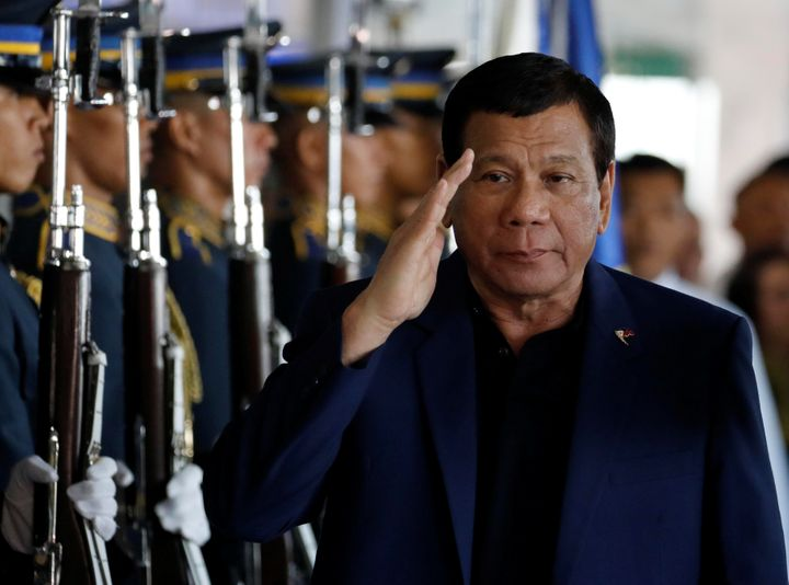 Philippine President Rodrigo Duterte salutes the honor guards upon arrival from Russia at the Ninoy Aquino International airp