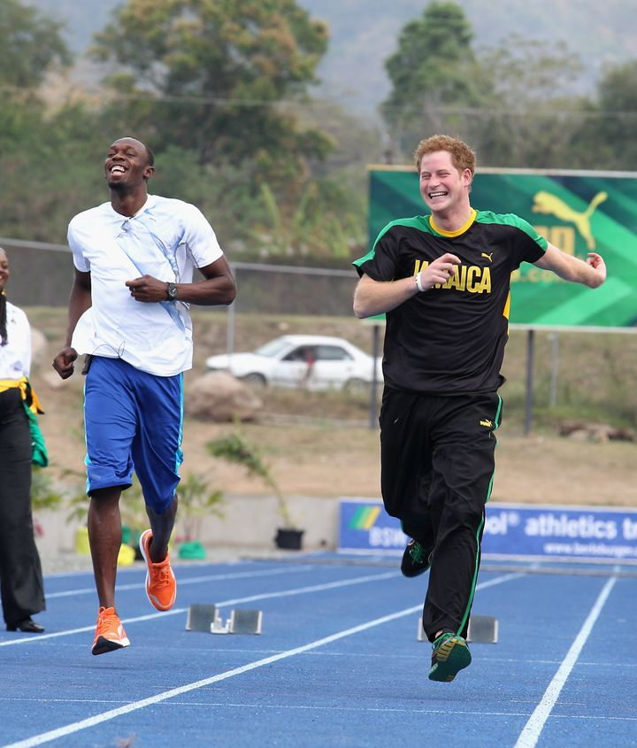 Prince Harry races Usain Bolt at the Usain Bolt Track at the University of the West Indies on March 6, 2012 in Kingston, Jama