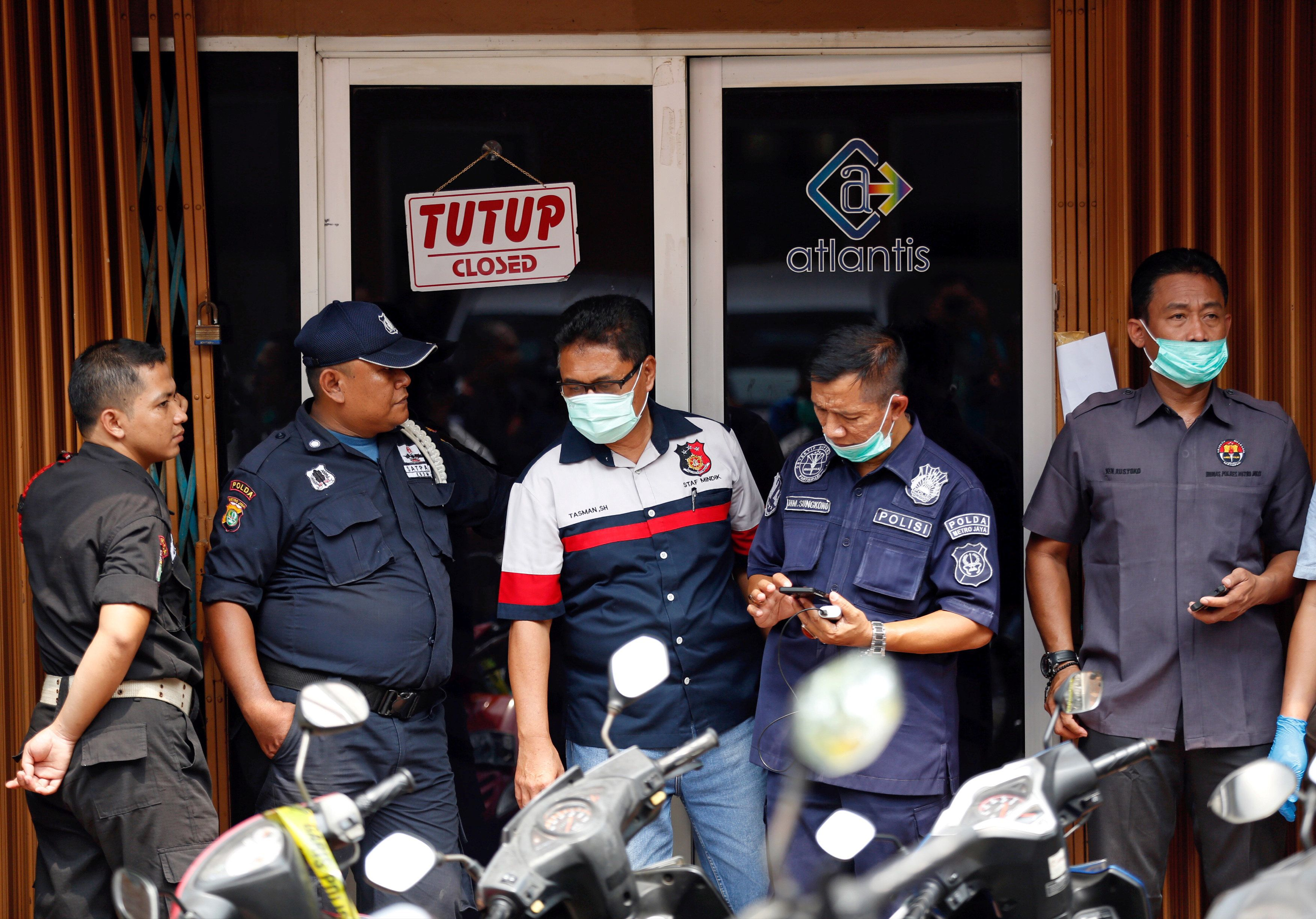 Police and security are seen outside the club where police detained 141 men for what they described as a gay prostitution ring in Jakarta, Indonesia May 23, 2017. REUTERS/Darren Whiteside     TPX IMAGES OF THE DAY