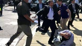 Man believed to be part of Turkish security detail repeatedly kicks US protester in the face