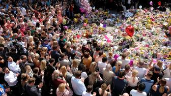 Members of the public attend a minute of silence for the victims of the Manchester Arena attack, in St Ann's Square, in central Manchester, Britain May 25, 2017. REUTERS/Darren Staples