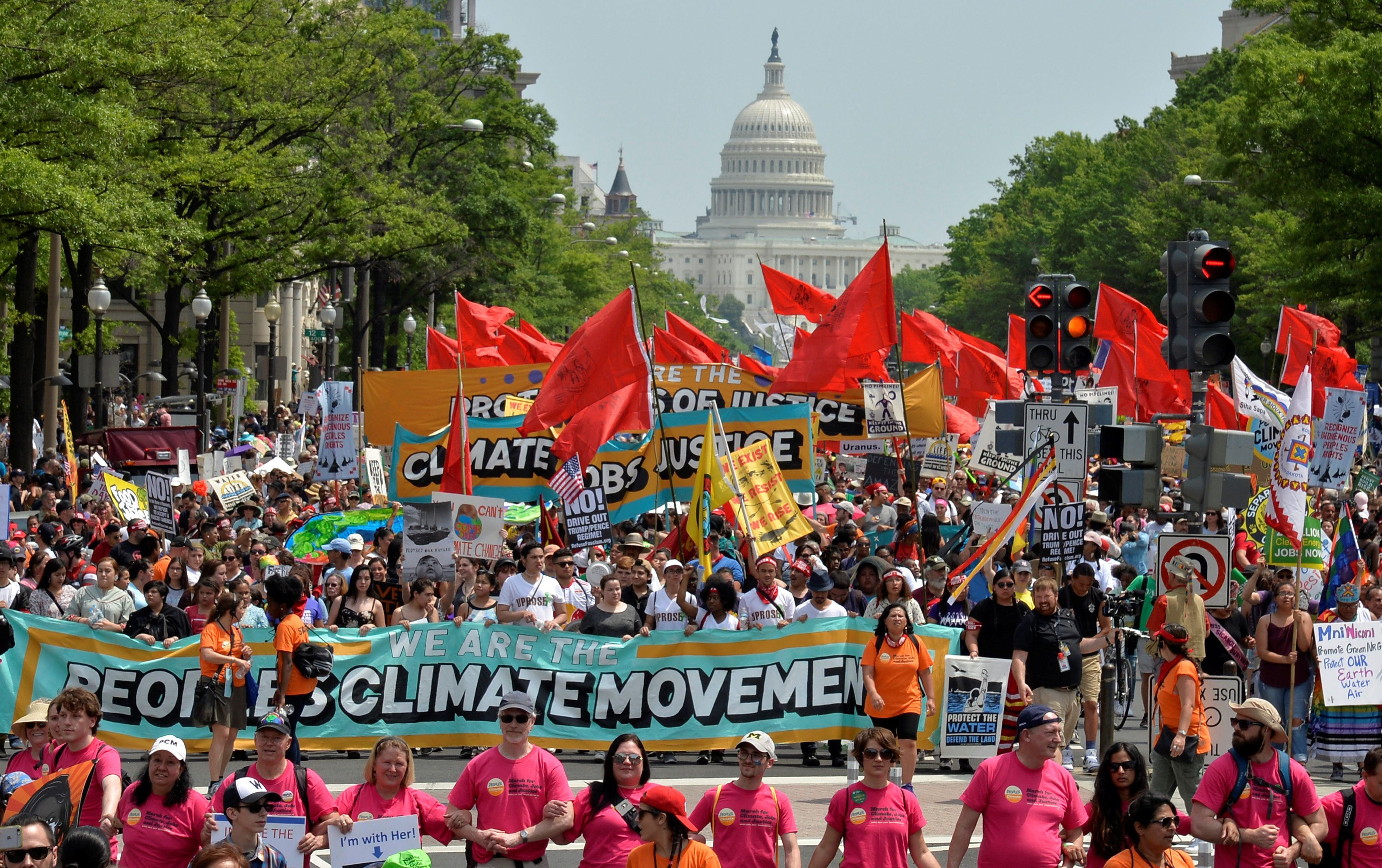 Demonstrators march down Pennsylvania Avenue during a People's Climate March, to protest U.S. President Donald Trump's stance on the environment, in Washington, U.S., April 29, 2017.     REUTERS/Mike Theiler       TPX IMAGES OF THE DAY
