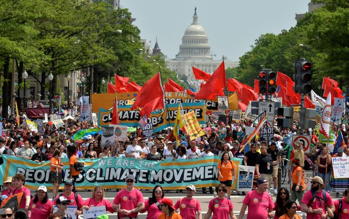 """Thousands took part in the <a href=""""https://www.huffpost.com/entry/climate-march-best-signs_n_590498b0e4b02655f83dd266"""" targe"""