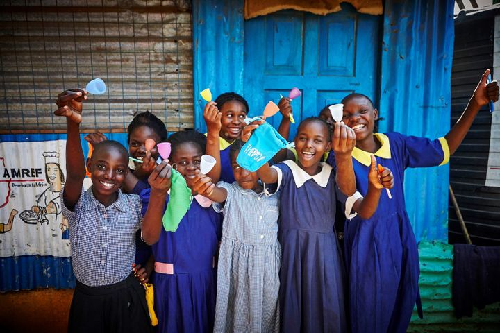 Girls in Nairobi, Kenya learning about menstrual cups with The CUP foundation.