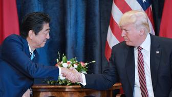 US President Donald Trump (R) shakes hands with Japanese Prime Minister Shinzo Abe during a bilateral meeting at the Villa Diodoro on the sidelines of the Summit of the Heads of State and of Government of the G7, the group of most industrialized economies, plus the European Union, on May 26, 2017 in Taormina, Sicily. The leaders of Britain, Canada, France, Germany, Japan, the US and Italy will be joined by representatives of the European Union and the International Monetary Fund (IMF) as well as teams from Ethiopia, Kenya, Niger, Nigeria and Tunisia during the summit from May 26 to 27, 2017. / AFP PHOTO / MANDEL NGAN        (Photo credit should read MANDEL NGAN/AFP/Getty Images)