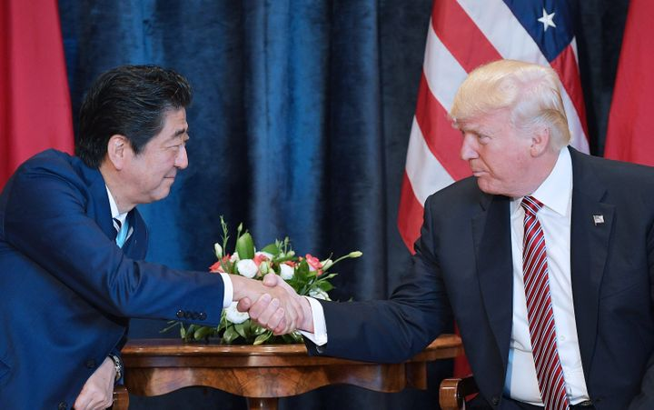 Japanese Prime Minister Shinzo Abe, left, discussed North Korea during a meeting with President Donald Trump on Friday o