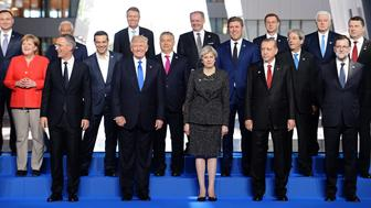 (Front row from L)  NATO Secretary General Jens Stoltenberg, US President Donald Trump, Britain's Prime Minister Theresa May, Turkish President Recep Tayyip Erdogan, Spanish Prime Minister Mariano Rajoy, (second row from L) German Chancellor Angela Merkel, Greek Prime Minister Alexis Tsipras, Hungary's Prime Minister Viktor Orban, Iceland's Prime Minister Bjarni Benediktsson, Italian Prime Minister Paolo Gentiloni, Latvia's President Raimonds Vejonis, (third row from L)  Polish President Andrzej Duda, Portuguese Prime Minister Antonio Costa, Romanian President Klaus Werner Iohannis, Slovakia's President Andrej Kiska, Slovenian Prime Minister Miro Cerar and Montenegro's Prime Minister Dusko Markovic  pose for a family picture during the NATO (North Atlantic Treaty Organization) summit at the NATO headquarters, in Brussels, on May 25, 2017.  / AFP PHOTO / POOL / Stefan Rousseau        (Photo credit should read STEFAN ROUSSEAU/AFP/Getty Images)