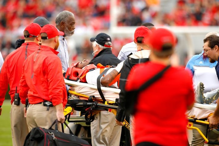 Devon Gales, shown as he is carted off the field on Sept. 26, 2015, is making progress after becoming paralyzed from the wais
