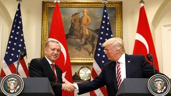 Turkey's President Recep Tayyip Erdogan (L) shakes hands with U.S President Donald Trump as they give statements to reporters in the Roosevelt Room of the White House in Washington, U.S. May 16, 2017. REUTERS/Kevin Lamarque