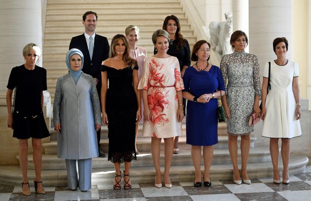 The spouses of NATO leaders gather for a photo before dinner at the Royal Castle in