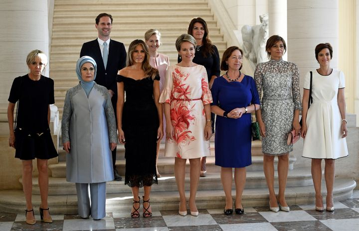 The spouses of NATO leaders gather for a photo before dinner at the Royal Castle in Laeken.