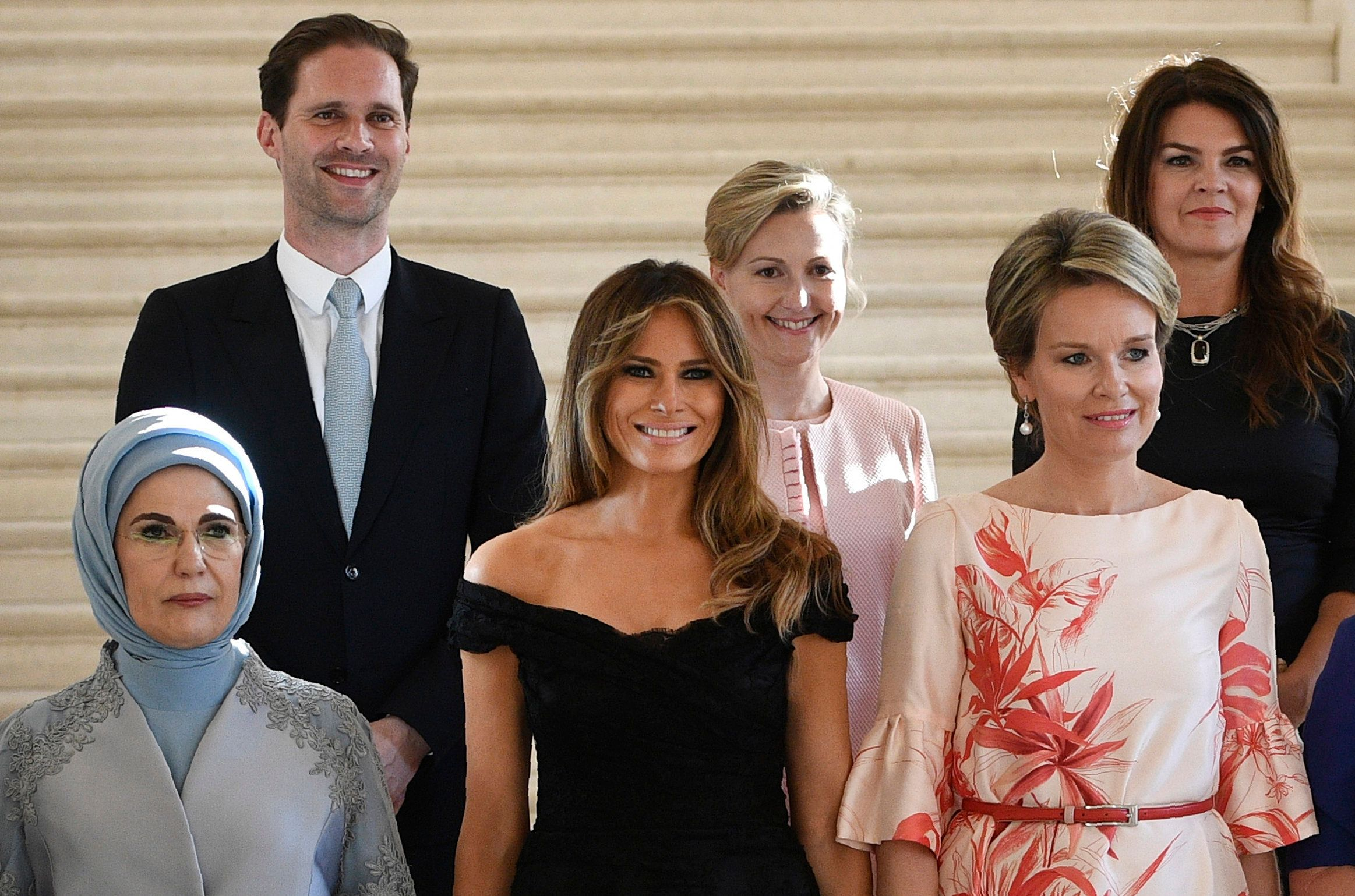 (Front row LtoR) First Lady of Turkey Emine Gulbaran Erdogan, First Lady of the US Melania Trump, Queen Mathilde of Belgium, (back row, LtoR) First Gentleman of Luxembourg Gauthier Destenay, partner of Slovenia's Prime Minister Mojca Stropnik and First Lady of Iceland Thora Margret Baldvinsdottir pose for a family photo before a diner of the First Ladies and Queen at the Royal castle in Laken/Laeken, on May 25, 2017, in Brussels. / AFP PHOTO / BELGA / YORICK JANSENS / Belgium OUT        (Photo credit should read YORICK JANSENS/AFP/Getty Images)
