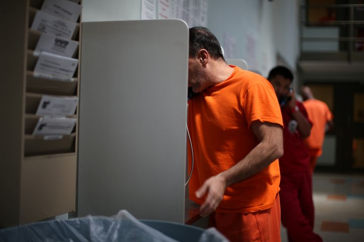 ICE detainees make phone calls at the Adelanto immigration detention center.