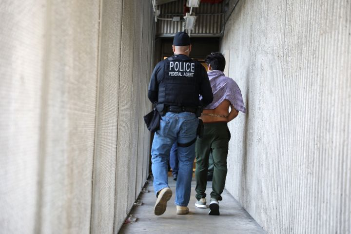 A U.S. Immigration and Customs Enforcement's (ICE) Fugitive Operations team member arrests an Iranian immigrant in Santa Ana,