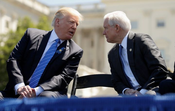 Trump speaks with Attorney General Jeff Sessions as they attend the National Peace Officers Memorial Service on May 15.