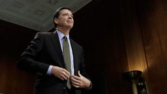 """FBI Director James Comey stands to be sworn in prior to testifying before a Senate Judiciary Committee hearing on """"Oversight of the Federal Bureau of Investigation"""" on Capitol Hill in Washington, U.S., May 3, 2017. REUTERS/Kevin Lamarque"""