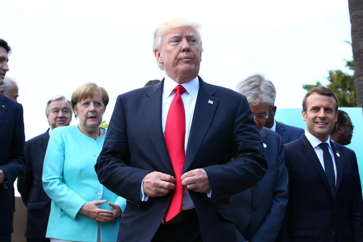 World leaders have pressed President Donald Trump to keep the U.S. in the Paris climate pact.