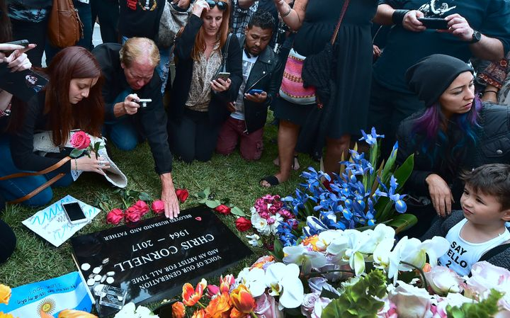 Fans visit the grave of Chris Cornell at Hollywood Forever Cemetery following a funeral service earlier in the day for the So