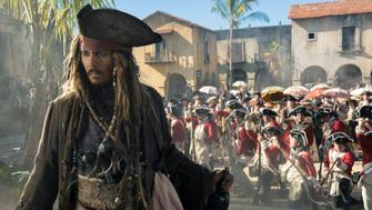 """PIRATES OF THE CARIBBEAN: DEAD MEN TELL NO TALES""..The villainous Captain Salazar (Javier Bardem) pursues Jack Sparrow (Johnny Depp) as he searches for the trident used by Poseidon..Pictured: Johnny Depp (Captain Jack Sparrow)..Ph: Peter Mountain..© Disney Enterprises, Inc. All Rights Reserved."