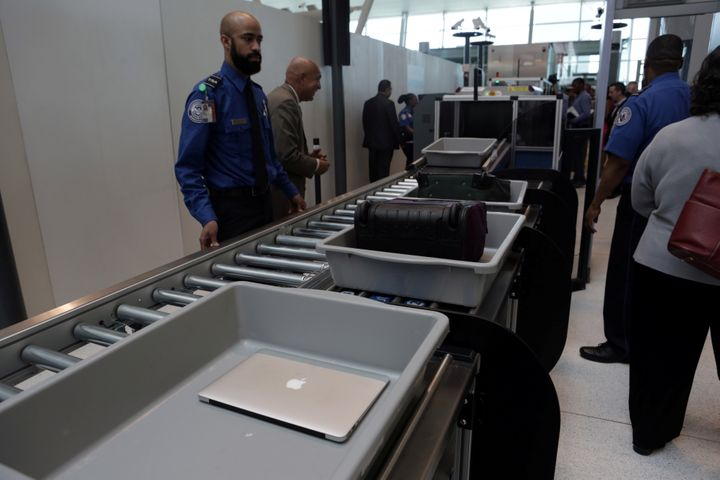 Baggage and a laptop are scanned using the Transport Security Administration's new Automated Screening Lane technology at Ter
