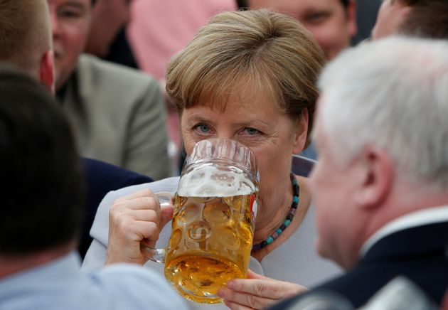 German Chancellor and head of the Christian Democratic Union (CDU) Angela Merkel drinks during the Trudering...