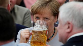 German Chancellor and head of the Christian Democratic Union (CDU) Angela Merkel drinks during the Trudering festival in Munich, Germany, May 28, 2017. REUTERS/Michaela Rehle