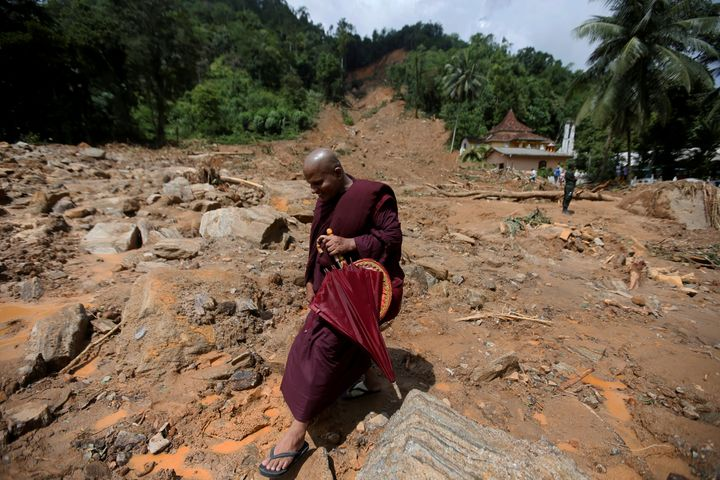 A Buddhist monk walks through a landslide site in Kalutara.